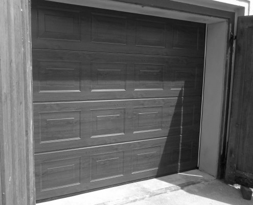 garagentor mit schlupft r. Black Bedroom Furniture Sets. Home Design Ideas